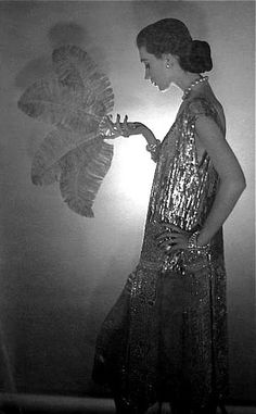 Dovima, wearing Chanel; photographed by Cecil Beaton.