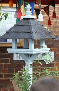 Robinson Garden - Bespoke Garden Products Selling a wide range of products including Birdtables, Dovecotes and Dog Kennels. Pictured is one of our bespoke wooden bird tables handmade and painted with the famous Farrow & Ball Colours. Visit our website for more details www.robinsongarden.co.uk