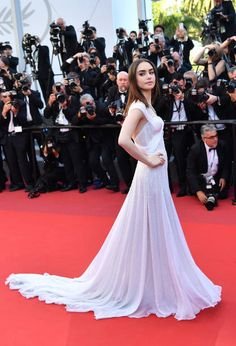 British actress Lily Collins poses as she arrives on May 19 2017 for the screening of the film 'Okja' at the 70th edition of the Cannes Film Festival...