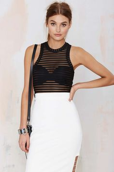 Nasty Gal Ain't Seen Nothin' Yet Sheer Tank Top. Team it up with a strappy bra, leather mini skirt, and make a serious impression.