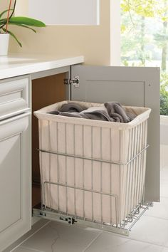 Have a hamper right where you need it, yet tucked away inside a cabinet out of sight, but not out of mind.