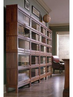 barrister_2.jpg (300×400) - barrister's shelves are an old way to keep dust off collections and books longer - glass cabinet doors fitted with UV filtered glass? - need some air circulation however to keep mustiness at bay