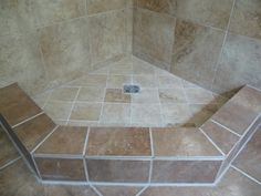corner shower with tile base..maybe one day in the half bath.