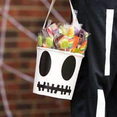 Duck Tape® brand duct tape DIY trick-or-treat bucket.