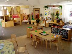 mira costa child development center classroom draping plants, soft light, wood tables, little areas, room, order