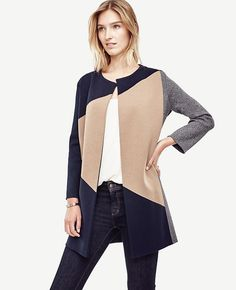 "Artfully colorblocked, this refined coat elevates your fall wardrobe a with modern nod. Long sleeves. 32 1/2"" long."