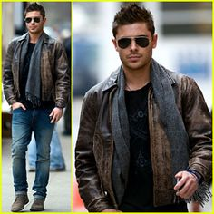 Zac Efron pulls off the black-brown combo expertly. Brown lace-up boots are matched with a brown bomber jacket over a black t-shirt. The aviator shades and grey scarf make this a masculine look that is well assembled without looking fussy. LOVE it!