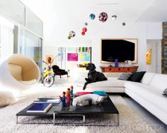 i love coffee tables that are low to the ground, fluffy rugs (in case it isn't obvious by now), white leather couches, and puppies!! oh, and egg chairs that float, and other colorful things that hang from the ceiling...yes! love!