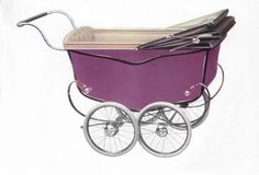 Here's a lovely photo from the Silver Cross archives, showing a 1930s pram in Royal Purple.