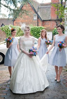 Lovely pale blue knee length bridesmaids dresses by @DessyGroup. Wedding dress by @sassholford.  Photo by @sarareeve