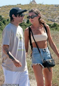 Kicking back: Louis was casually clad in a simple T-shirt and baggy white shorts for his t. Eleanor Calder Style, Louis And Eleanor, Romantic Breaks, Stunning Brunette, Love U Forever, Louis Williams, Crop Top Bikini, Perrie Edwards, I Love One Direction
