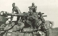 America's 761st all black tank battalion known as the Black panthers. Pose with their Sherman tank...