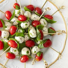A simple twist on a traditional Caprese salad, these colorful skewers of ripe cherry tomatoes, fragrant basil and fresh mozzarella are an easy, no-cook appetizer that looks every bit as good as it tastes. Birthday Snacks, Snacks Für Party, Birthday Dinners, Ensalada Caprese, Caprese Salad, Caprese Skewers, Yummy Appetizers, Appetizer Recipes, Italian Finger Foods