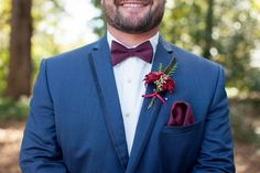 Classic navy blue fall wedding groom outfit idea - navy blue suit with white button down shirt + burgundy bow tie + pocket square and matching boutonniere {Amy E Photography}