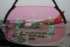 Looking through the HUD of a Hainan Airlines 787 at a sister ship.
