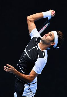 Roger Federer Photos Photos - Roger Federer of Switzerland serves during a practice session ahead of the 2017 Australian Open at Melbourne Park on January 14, 2017 in Melbourne, Australia. - 2017 Australian Open - Previews