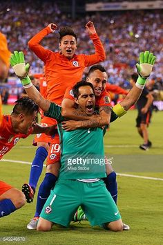 Claudio Bravo of Chile is mobbed by his teammates after defeating Argentina to win the Copa America Centenario Championship match at MetLife Stadium. Claudio Bravo, Copa America Centenario, Metlife Stadium, World Football, Goalkeeper, Soccer, Fitness, Pictures, Lovers