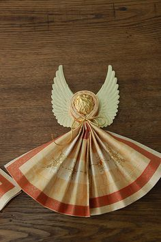 Angel made with Ferrero choc. and napkin to be placed on plate.  Also made with homemade wings and white napkins - For the Love of Food