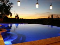 Infinity edge pool with beautiful hanging lights