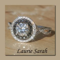 diamond engagement ring with black and white diamond round double halo - but with blue saphires instead of black diamonds