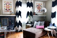 Chevron curtains and bright colored prints. via the HUNTED INTERIOR