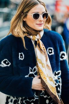 03c2c81bc Layering your turtlenecks with a coat or a sweater is always a good idea!  Olivia Palermo braving the cold with a yellow turtleneck and a printed fur  jacket.