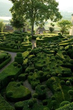 The Château de Marqueyssac is a 17th century chateau and gardens located at Vézac, in the Dordogne Department of France.   #France #Jardins_de_Marqueyssac #Topiaries