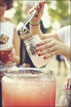 Wedding punch served in mason jars #wedding #DIY