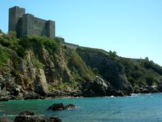 Tuscany beaches with medieval castles...La Rocca at Talamone, Maremma in April