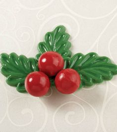Cute holly and berries chocolate candies from @Wilton Cake Decorating! #wiltoncookieelf