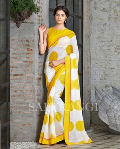 White and yellow printed sari 1. White and yellow organic linen sari2. Comes with matching unstitched blouse