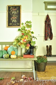 Add branches to rubber rain boots for your fall entry