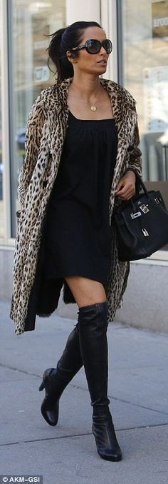 She was in a knee-length leopard-print coat - which she left unbuttoned...