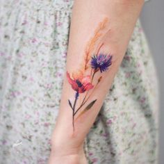 Watercolor floral tattoo by Magdalena Bujak