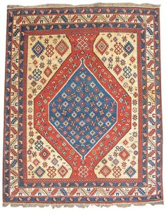 """Shirvan, 19th C (3rd Q),  Caucasus - This Shirvan rug from the East Caucasus blends sections of bold color with glimmering bursts of ornament. Using the traditional articulation of 19th-century Persian medallion carpets, a blue medallion floats against a red ground flanked by joining golden corner-pieces. This piece, however, is anything but formal and instead relies on an almost primordial sense of shape and graphics. W: 4' 6"""" x L: 5' 0"""""""