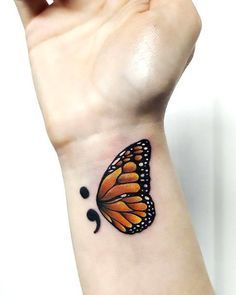 A meaningful tattoo of a semicolon with a butterfly wing symbolizes new beginning. Color: Brown. Tags: Cute, Meaningful