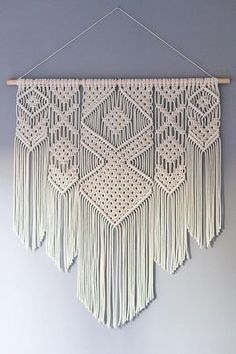 A beautiful bohemian inspired handmade macrame wall hanging. Use this decorative wall hanging to add a handmade touch to your home, office or cabin. I first started experimenting with making macrame wall hangings last year, when I made a few wall hangings for myself and friends. I love to design my new wall hangings, choosing my new piece of driftwood and combine it with the right geometrical shape. -Made to order- Product details: 100% cotton 5mm rope on a wooden dowel Width of the dowel…
