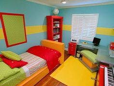 The Design on a Dime team designed a space that put the fun back in functional. Bright aqua-hued walls with a contrasting lemon-colored horizontal stripe set a vibrant backdrop for the new space. Design coor…