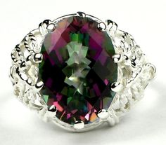 SR260, 7 ct Mystic Fire Topaz, 925 Sterling Silver Ring * Stone Type - Mystic Fire Topaz * Approximate Stone Size - 14x10mm  * Approximate Stone Weight - 7 cts  * Jewelry Metal - Solid 925 Sterling Silver * Approximate Metal Weight - 3.2 grams  * Ring Size - Size selectable during checkout * Our Warranty - A full year on workmanship  * Our Guarantee - Totally unconditional 30 day guarantee