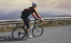 Mateusz going up to Praded with Warm Orange long sleeve jersey