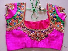 Fuchsia pink raw silk designer bridal blouse with cap sleeves and round neck patterned. Thread work embellished floral bunches adorned ar...