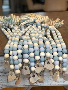 Bead strand with hand painted mint and grey beads mixed in with raw unpainted beads. On the other aide a wood heart charm. Wood Bead Garland, Diy Garland, Beaded Garland, Christmas Bead Garland, Crafts To Do, Fall Crafts, Bead Crafts, Diy Crafts, Wooden Crafts