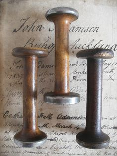 old wooden mill bobbins