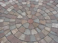 Pavers make the world, or at least this patio go round., We have a wrap around porch on our house but needed a place for a table and chairs. Block Paving Driveway, Brick Pavers, Landscaping Supplies, Home Landscaping, Deck With Pergola, Pergola Ideas, Patio Ideas, Backyard Ideas, Garden Ideas