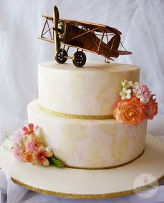 Air Aroha Wedding Cake - Made for a pilot and cabin crew member from Air New Zealand that tied the knot ♥ Vintage Pink and Gold themed wedding was subtly incorporated into the 'marbling' of the fondant and in the flowers. Plane was to be a keepsake so we found on off ebay, sanded it down and spray painted it a vintage gold to go with the theme