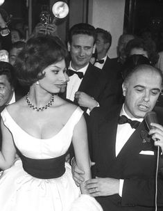 """5/15/1959 Cannes, France: Italian actress Sophia Loren and her husband, producer Carlo Ponti (right), leave a theater here May 13th after viewing the Italian film """"Enfer de la Ville"""" (Hell of the City)."""