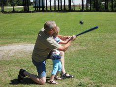 PapPap helping paisley hit her first ball !