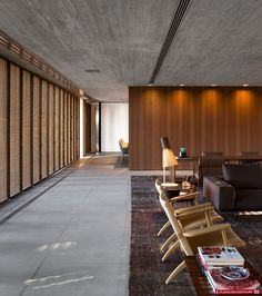three stacked concrete volumes create a home with distinct and constant connections to the exterior.
