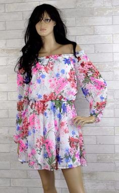 bcf40fa38a So very pretty and feminine floral dress. White with neon pink and pretty  blues.