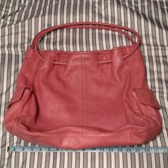 """Lg Purse Jones NY pink True pink leather purse about 17"""" by 12"""" by 4"""". Lots of pockets on the inside. Some marks on the inside, nothing anyone would see if you are reaching for something in it. Some marks on the bottom as expected from a pre-loved bag. No tears, no scuffs. Jones New York Bags"""